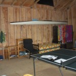 The cabin is one large space with a wood stove.